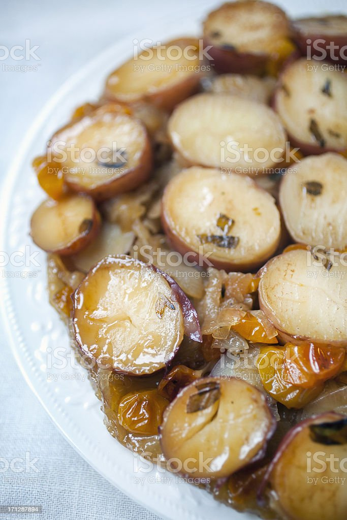 roasted potato and caramelized onion tatin stock photo