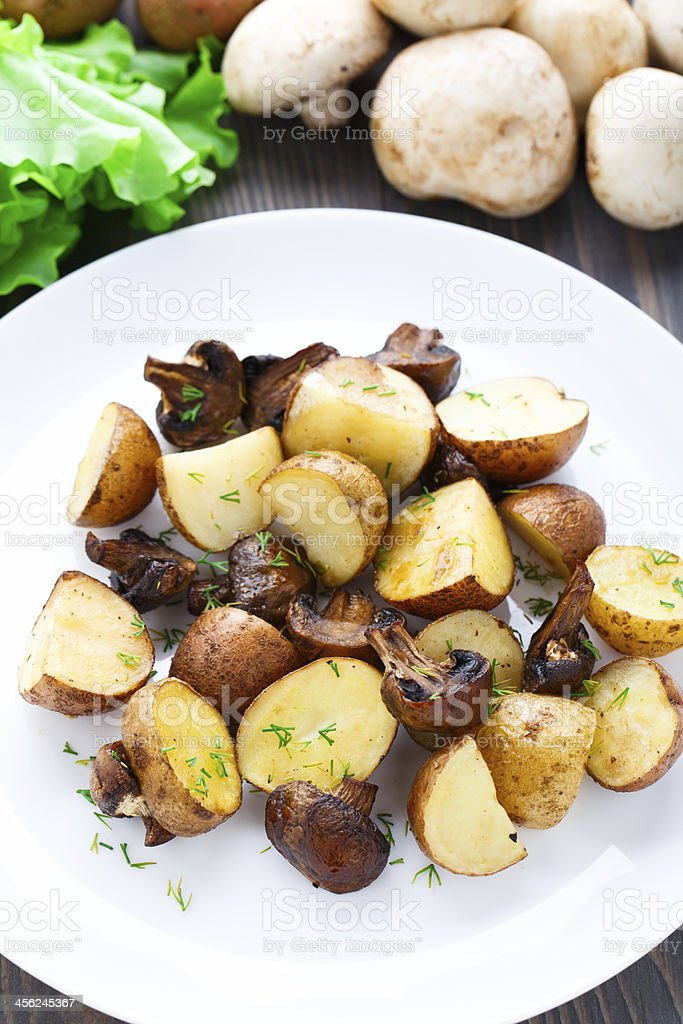 Roasted potato and mushrooms stock photo