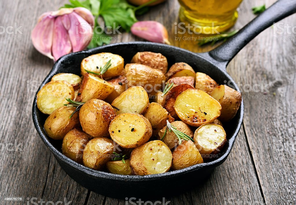 Roasted potato in frying pan stock photo