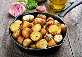 Roasted potato in frying pan