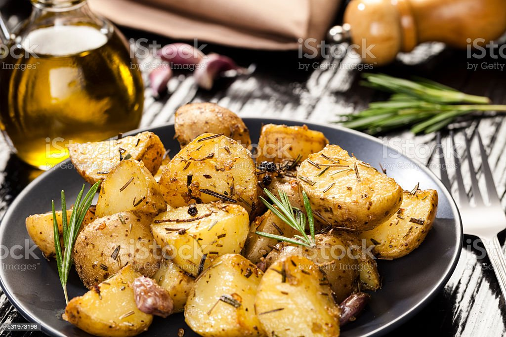 Roasted potatoes stock photo