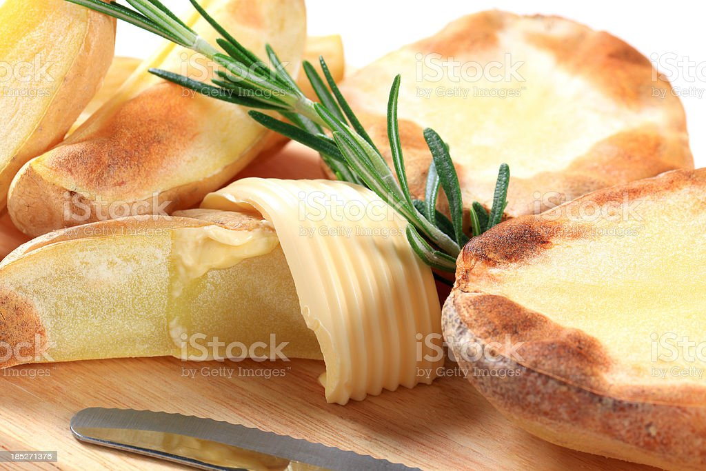 Roasted potatoes with butter royalty-free stock photo
