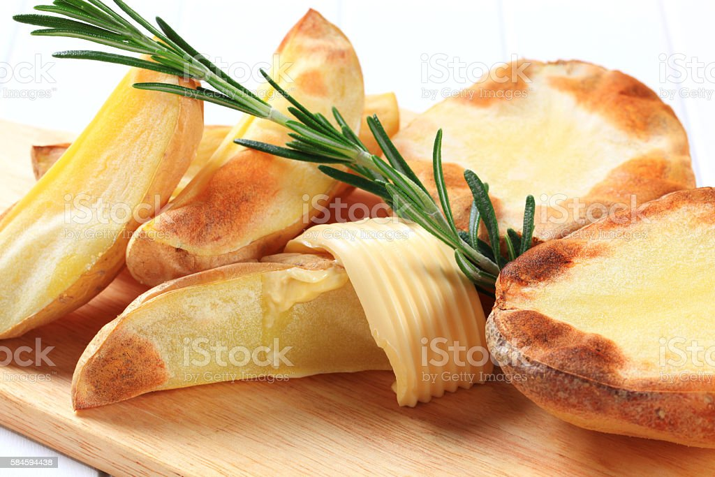 roasted potatoes with butter stock photo