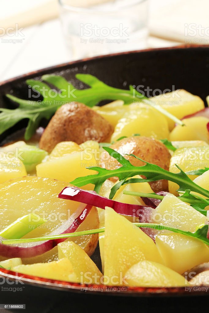 Roasted potatoes with onion stock photo