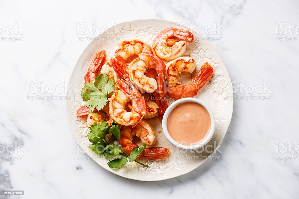 Roasted Prawns with cocktail sauce stock photo