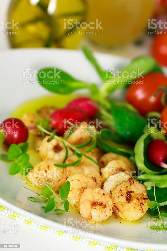 Roasted prawns with corn salad,cherry tomatoes and sauce stock photo
