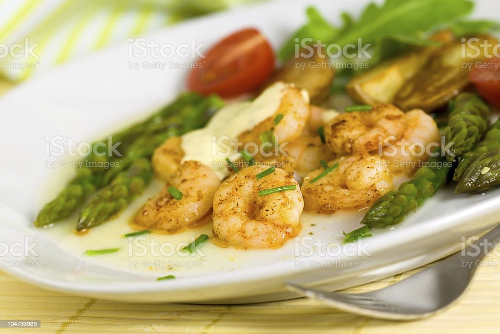 roasted prawns with green asparagus and potato royalty-free stock photo