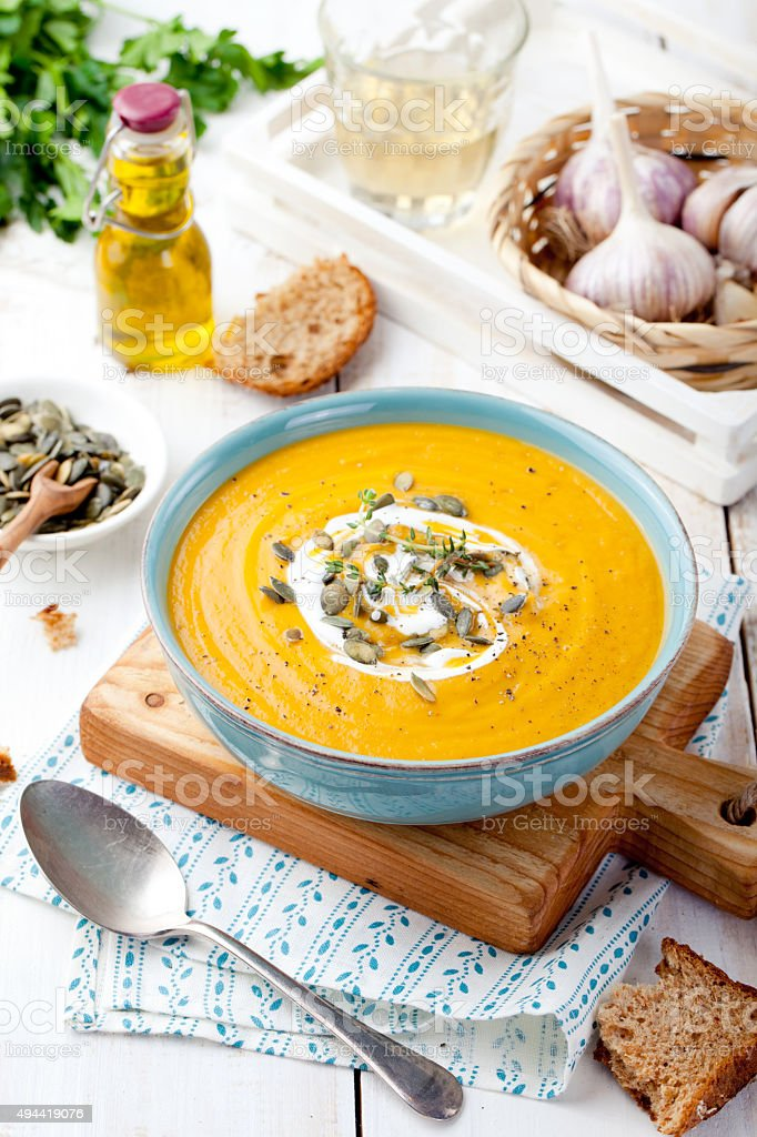 Roasted pumpkin and carrot soup with cream . stock photo