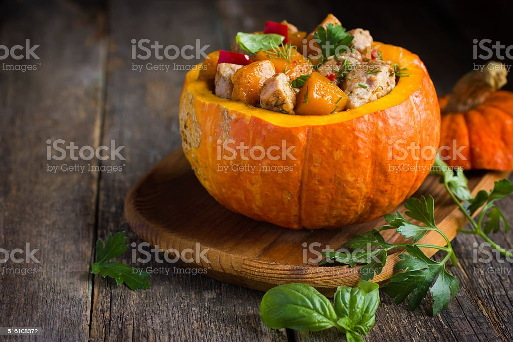 Roasted pumpkin, meat, bell peppers and red onion stock photo