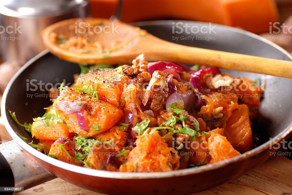 roasted pumpkin with walnuts and onions stock photo