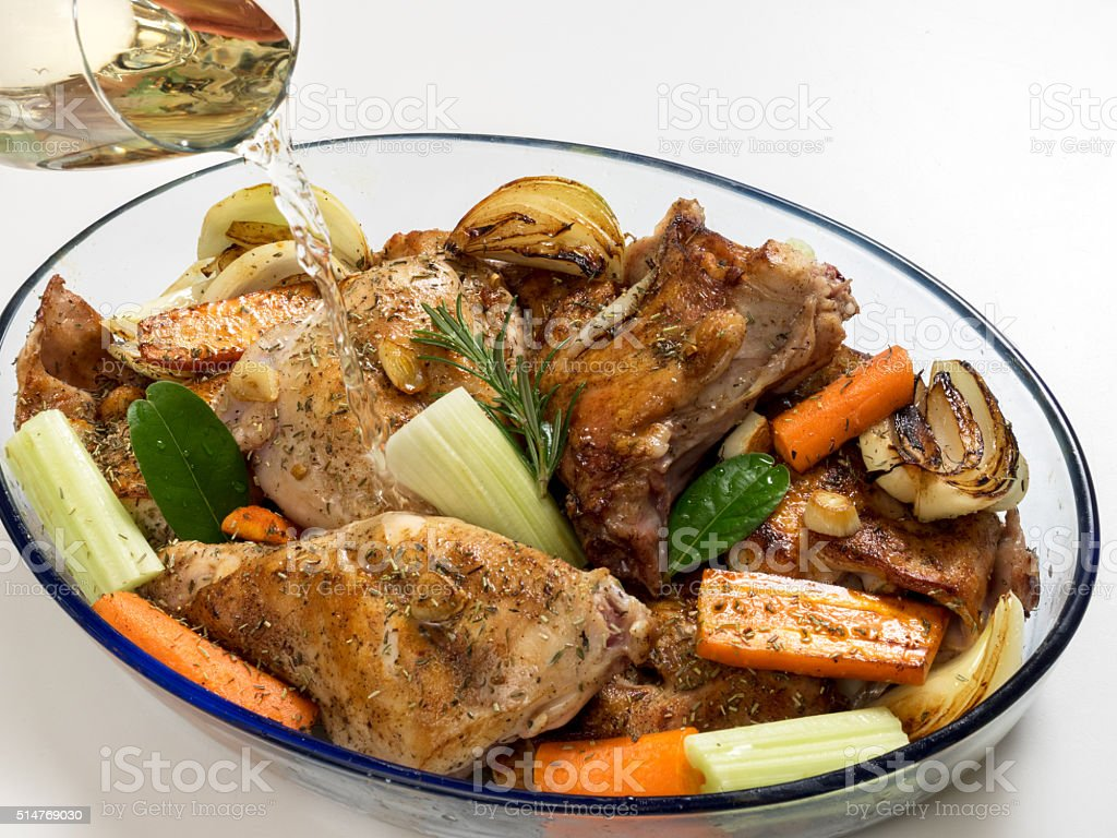 Roasted rabbit with herbs, vegetables and white wine sauce royalty-free stock photo