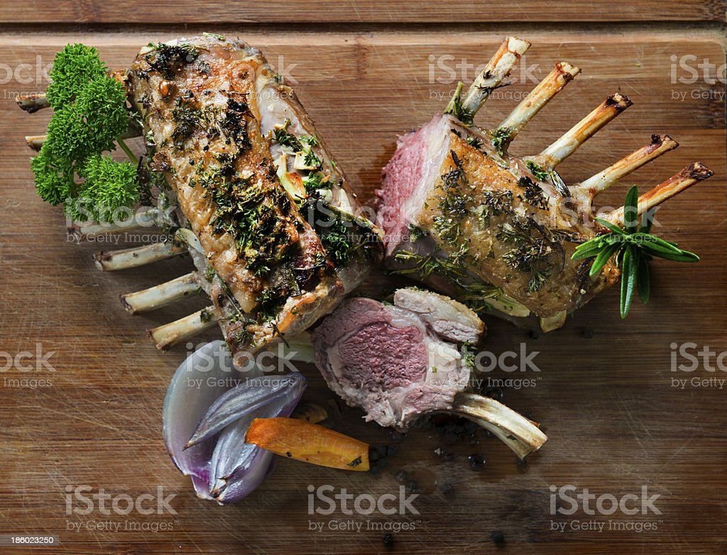 Roasted rack of lamb with parsley sage rosemary and thyme stock photo