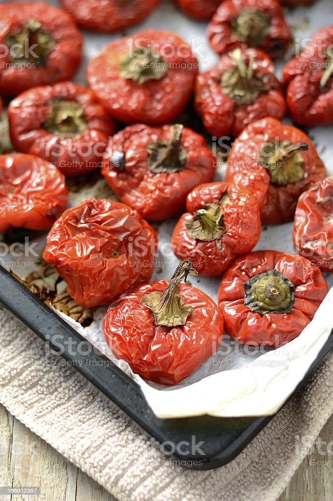 Roasted red peppers on a baking tray royalty-free stock photo
