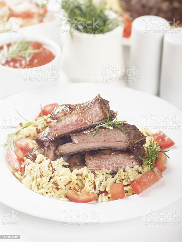 Roasted ribs with risotto royalty-free stock photo