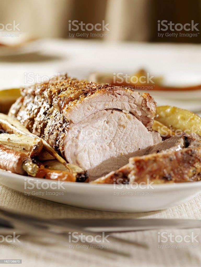 Roasted Rolled Pork Rib Roast with Potatoes stock photo