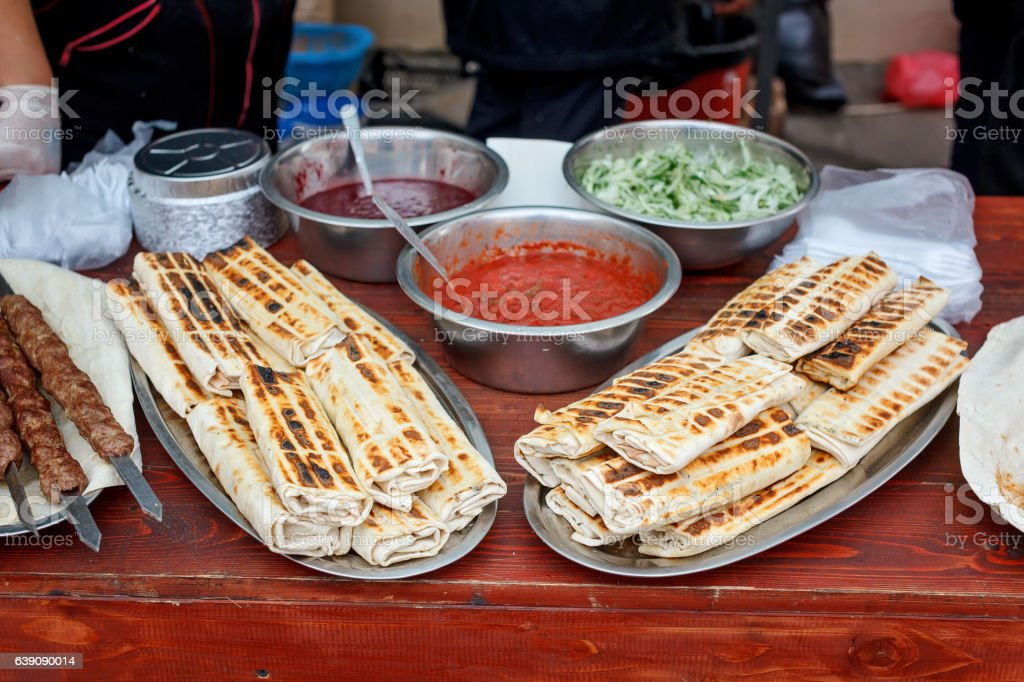 Roasted rolls of bread lavash filled with herbs feta cheese. stock photo