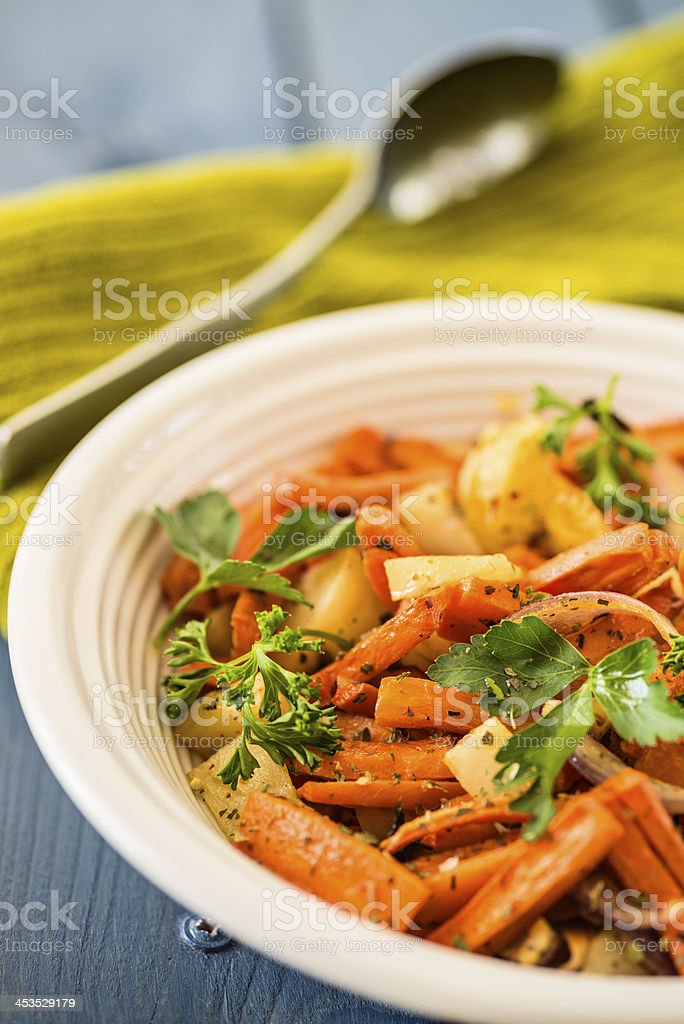 Roasted root vegetable with herbs stock photo