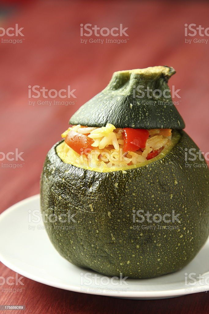 Roasted round zucchini stuffed rice and vegetables royalty-free stock photo