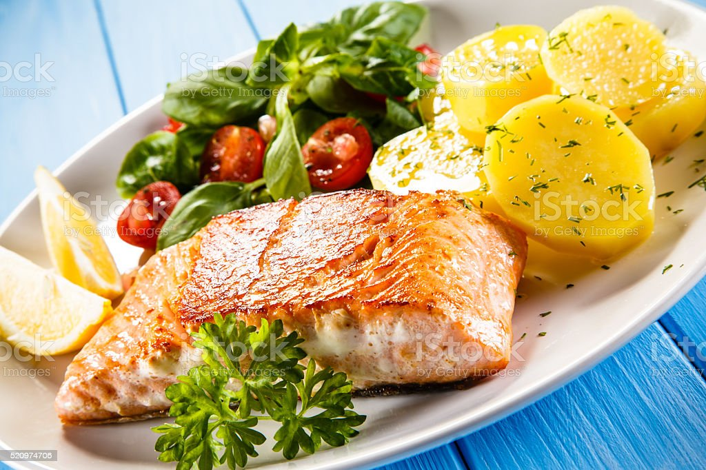 Roasted salmon and vegetables stock photo