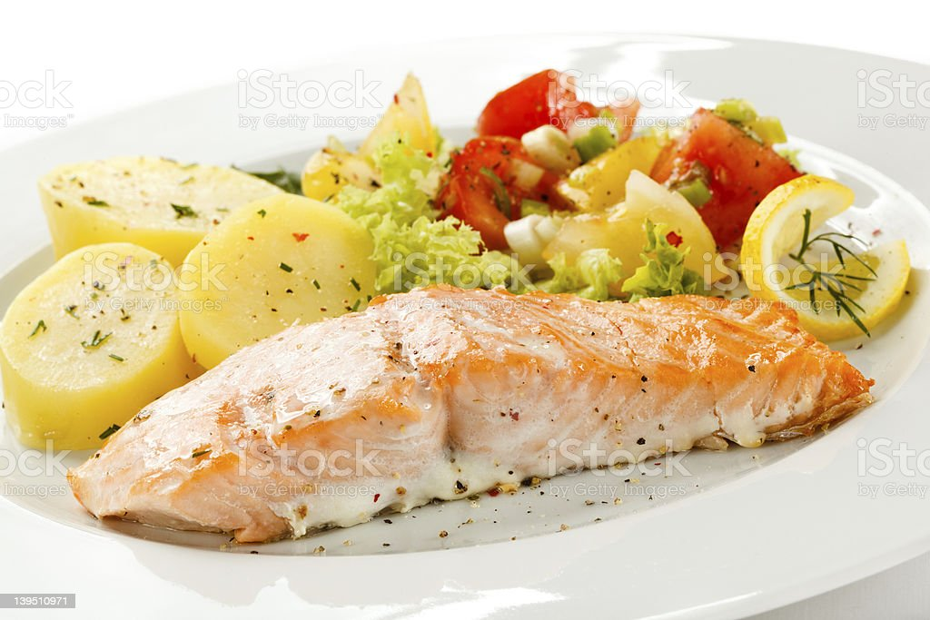 Roasted salmon, boiled potatoes and vegetables royalty-free stock photo
