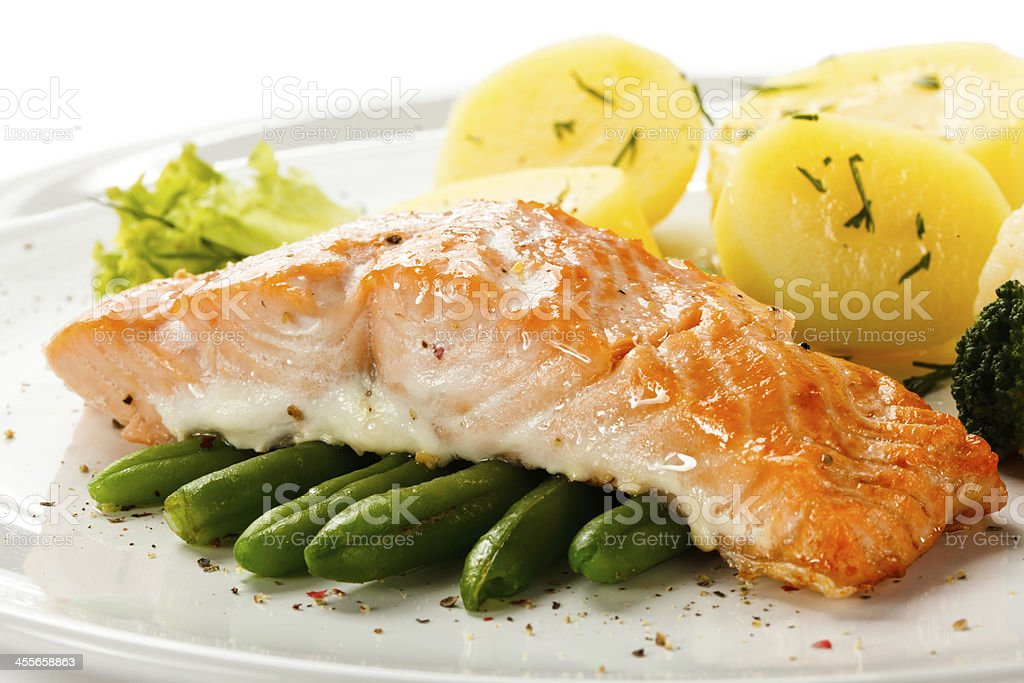 roasted salmon, boiled potatoes and vegetables stock photo