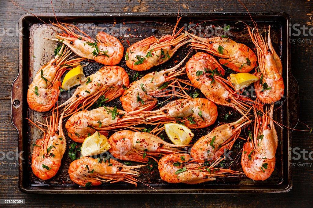 Roasted shrimp comb on baking sheet background stock photo