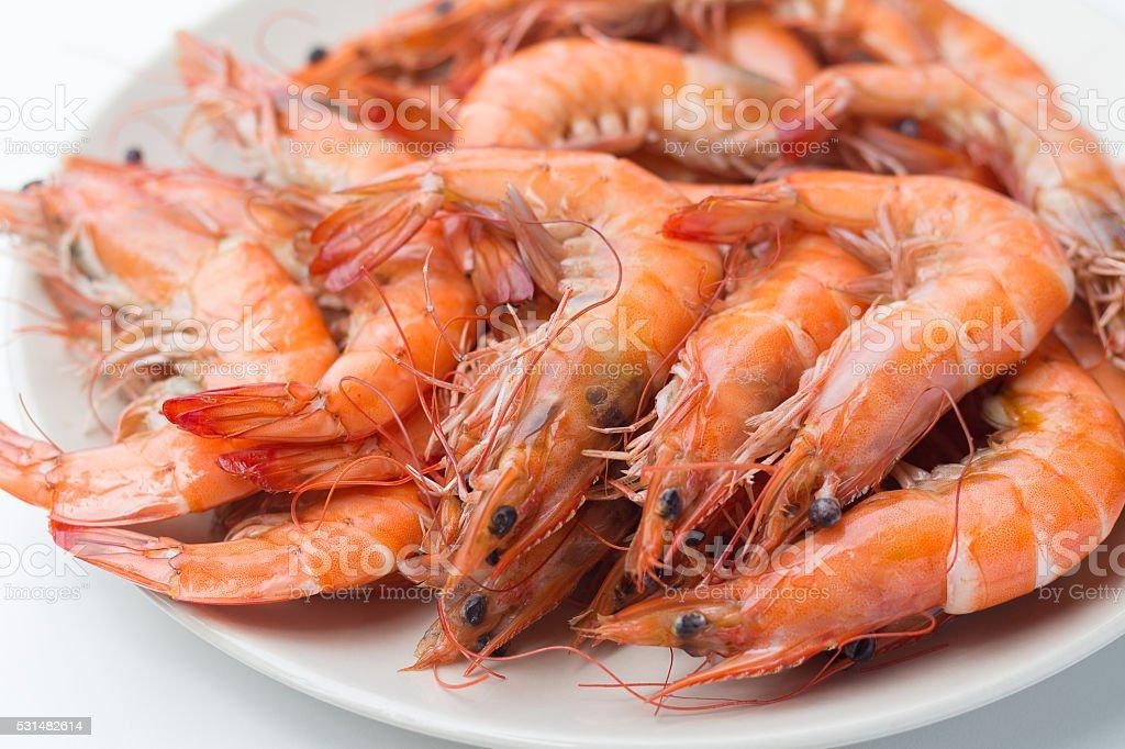 roasted shrimp on white plate stock photo