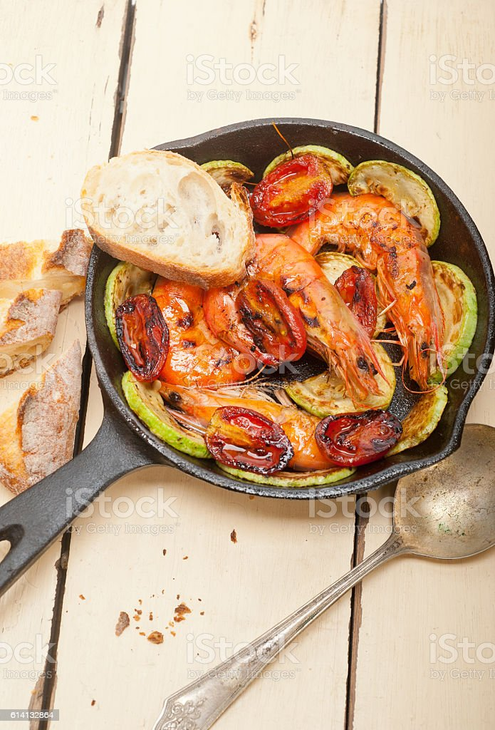 roasted shrimps with zucchini and tomatoes stock photo