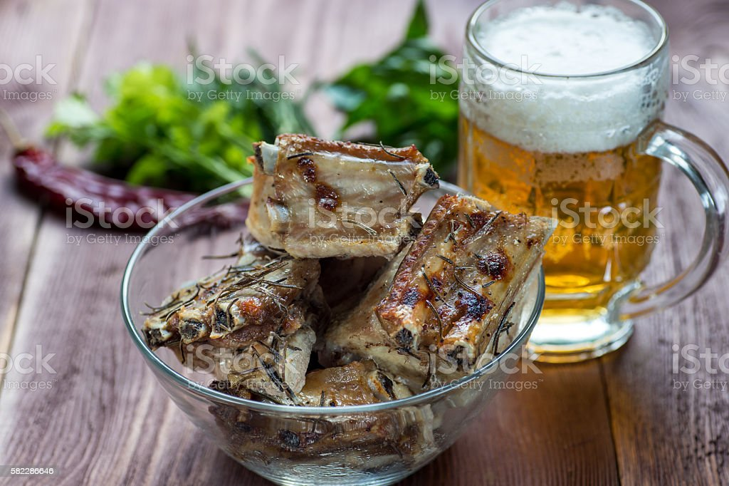 Roasted sliced barbecue pork ribs, focus on sliced meat stock photo