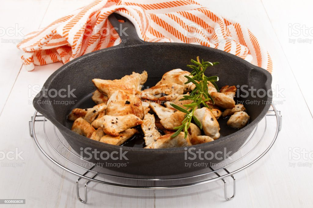 roasted sliced turkey breast with rosemary in a pan stock photo
