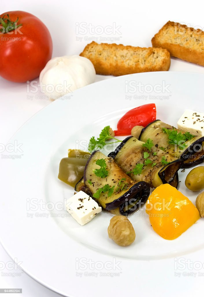 roasted slices of eggplant,chestnuts,cheese,vegetables royalty-free stock photo