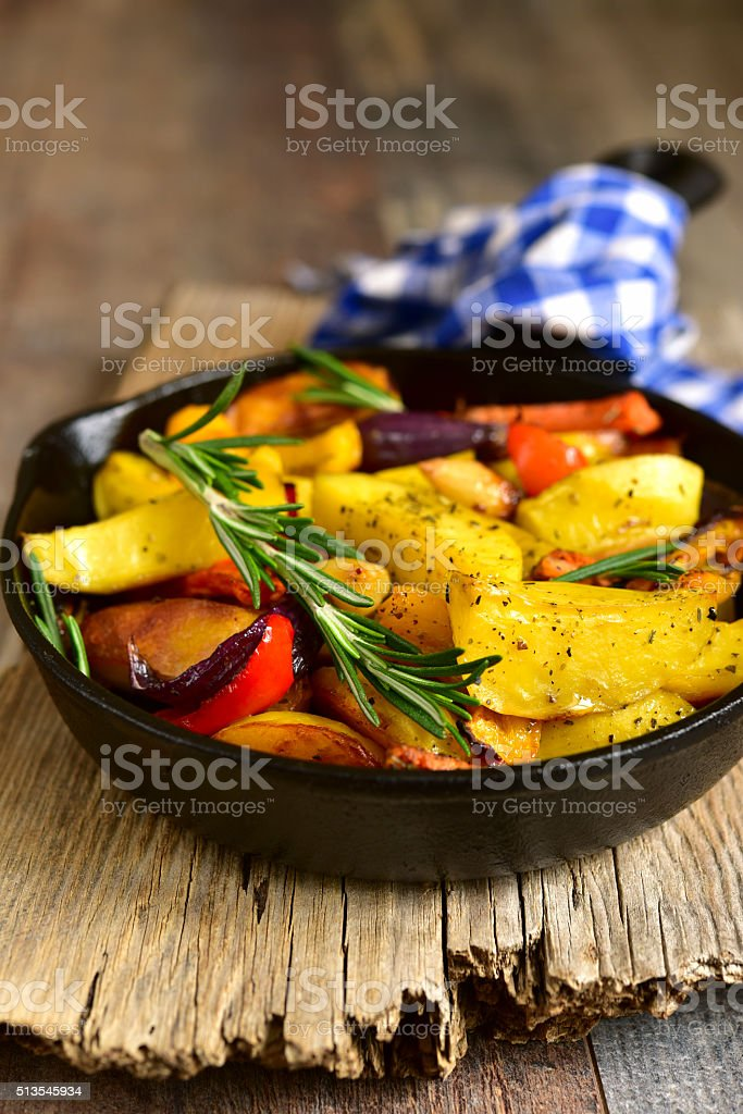 Roasted spring vegetables with rosemary and garlic. stock photo