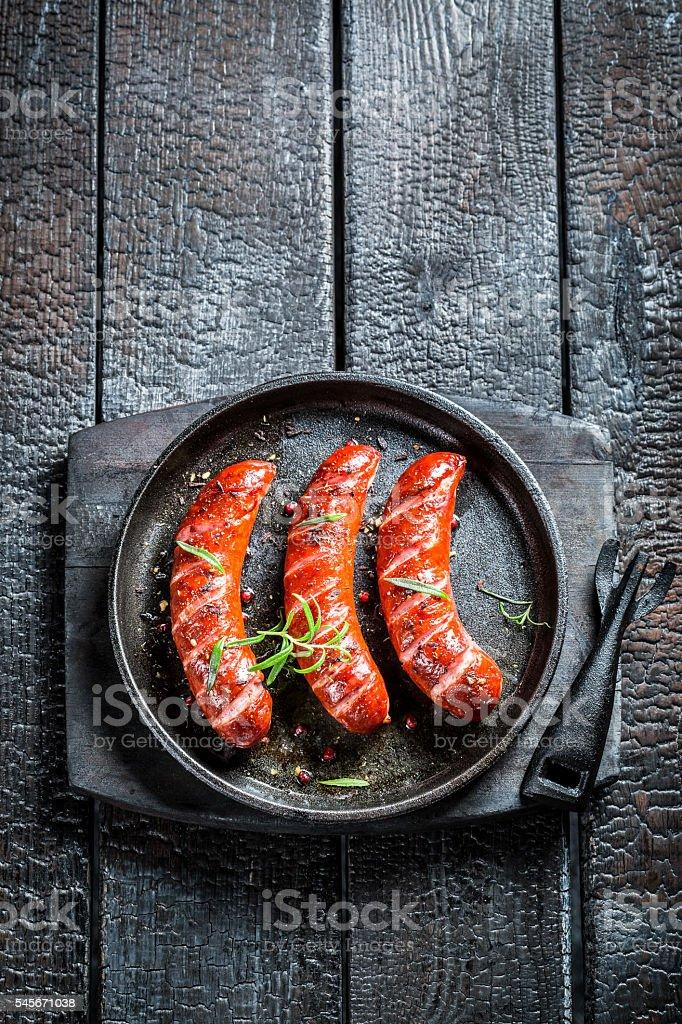 Roasted three sausage with fresh rosemary stock photo