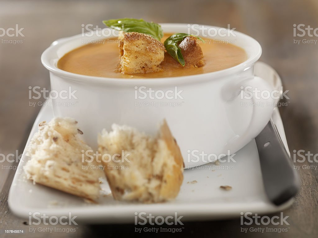 Roasted Tomato and Basil Bisque with Crusty Bread stock photo