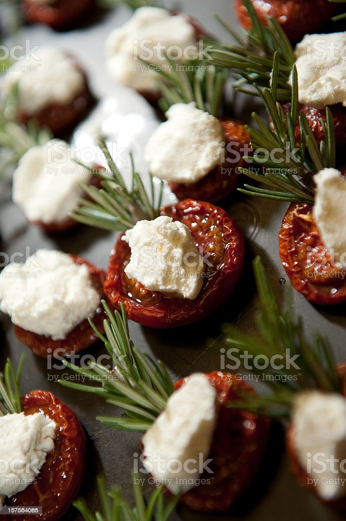 Roasted Tomato, Goat Cheese and Rosemary Appetizer royalty-free stock photo