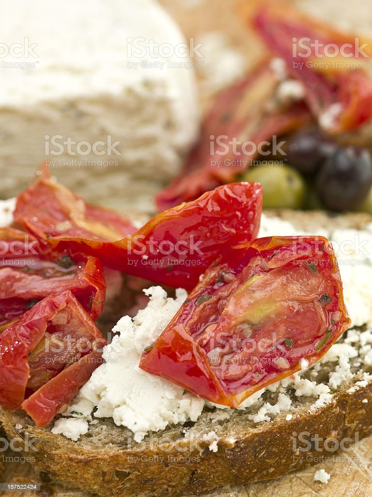 Roasted tomatoes and french spreadable cheese sandwich royalty-free stock photo