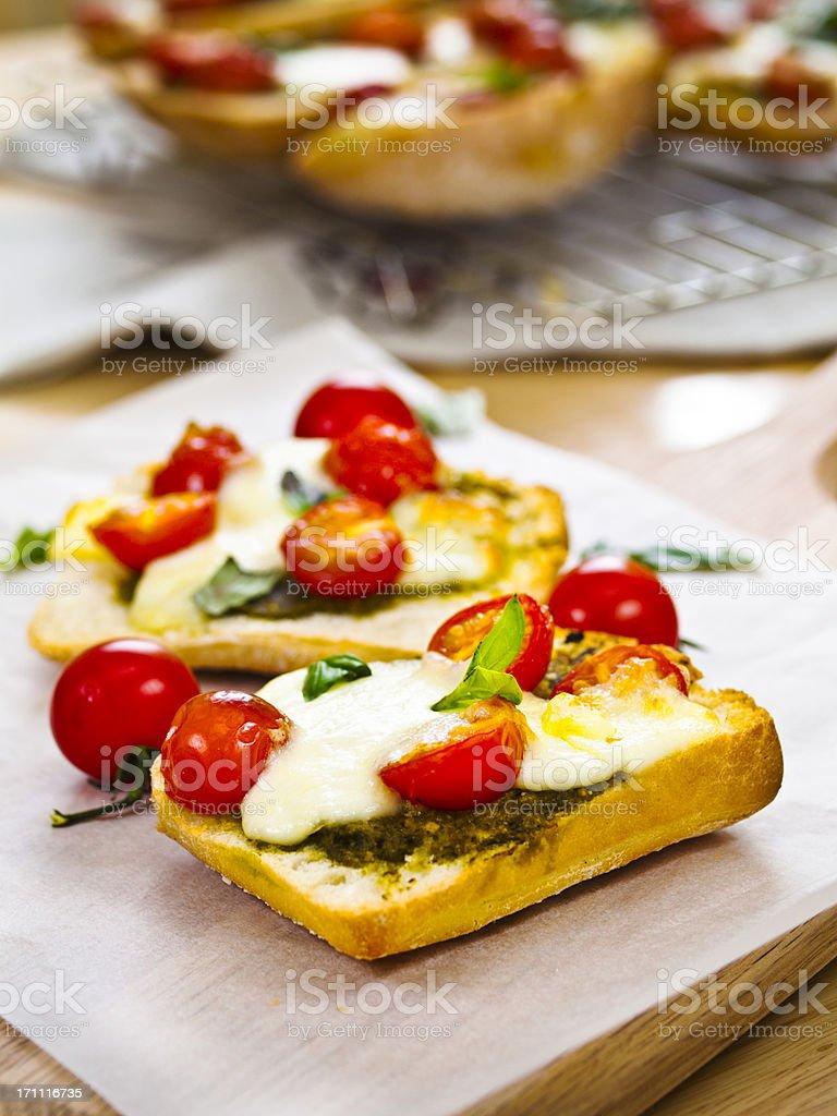 Roasted tomatoes on garlic ciabatta royalty-free stock photo