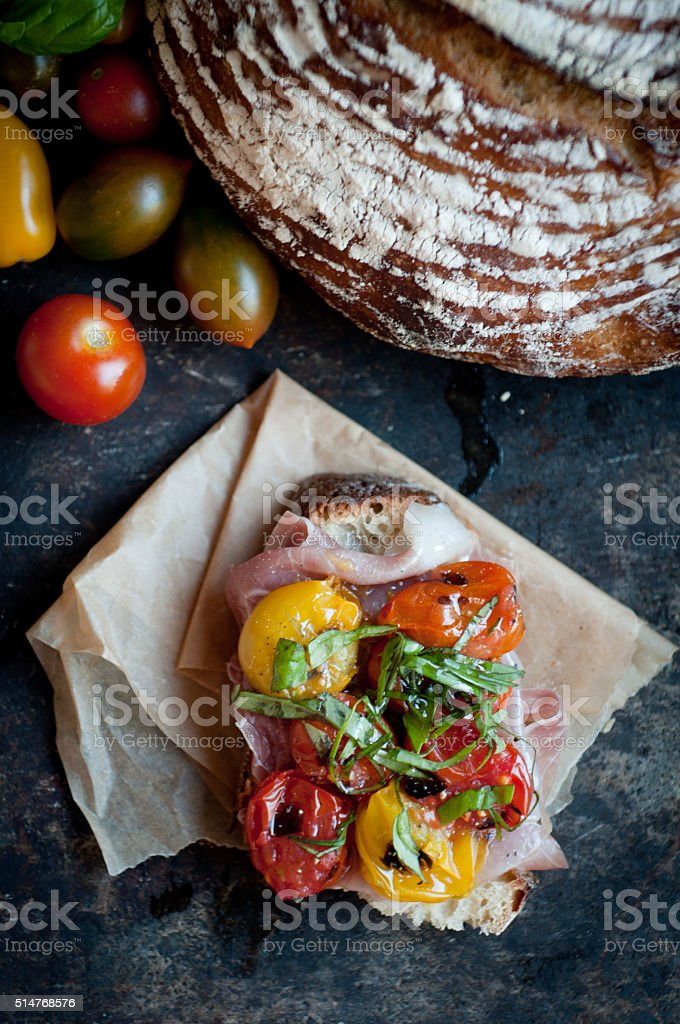 Roasted Tomatoes on Rustic Sourdough stock photo