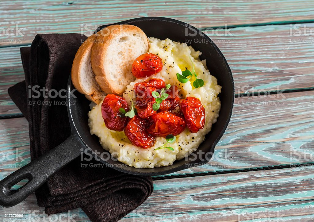 Roasted tomatoes with goat cheese polenta stock photo