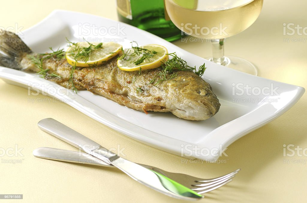 Roasted trout with lemon and dill royalty-free stock photo