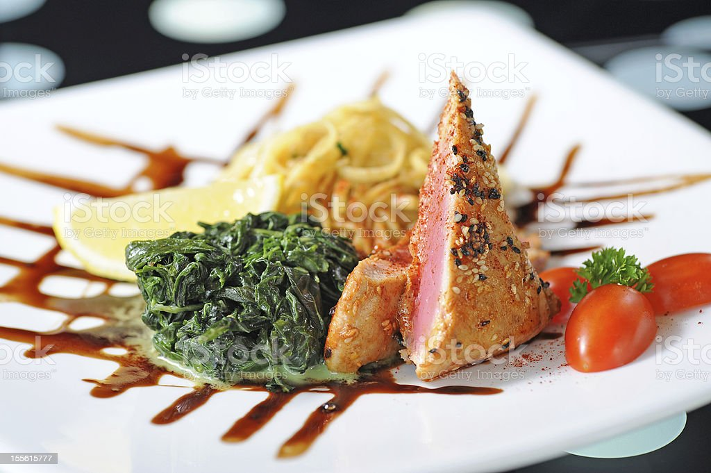 roasted tuna slices with black sesame stock photo