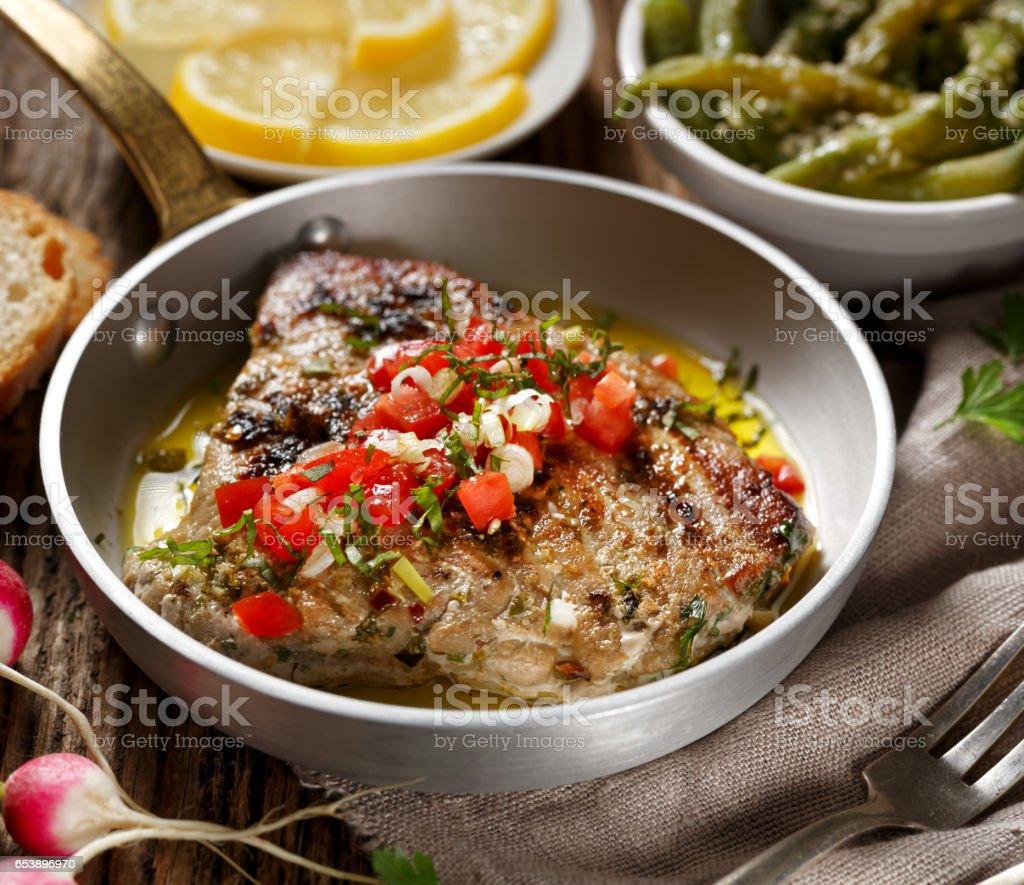 Roasted tuna steak with the addition of tomato salsa stock photo