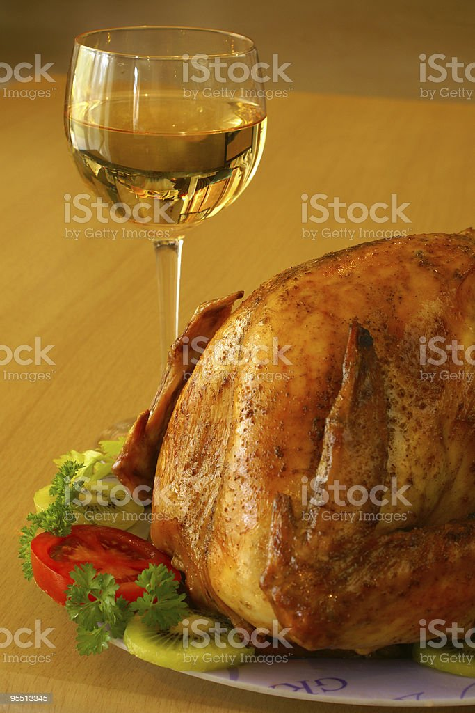 Roasted turkey and glass of wine royalty-free stock photo