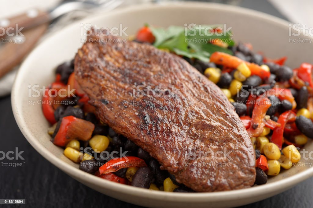 Roasted turkey with black bean salad stock photo