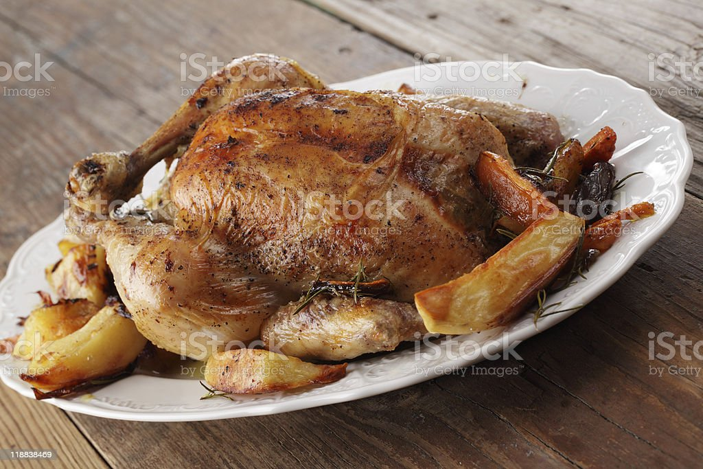 Roasted turkey with vegetables stock photo