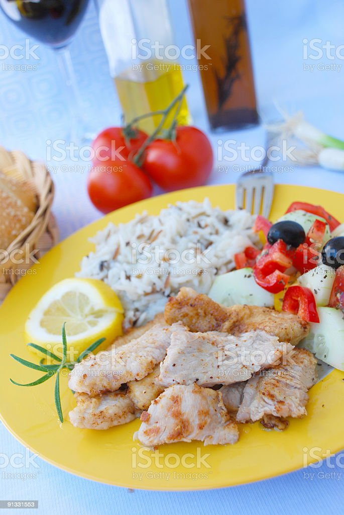 Roasted Turkey with wild rice and salad  -  3 royalty-free stock photo