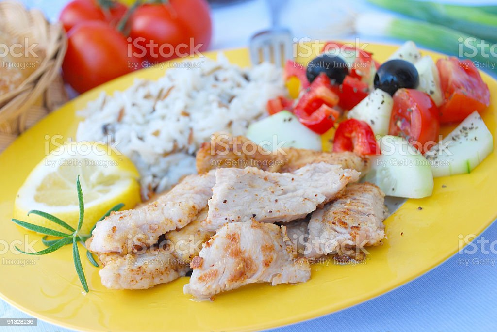 Roasted Turkey-Slices with Wild Rice and Salad royalty-free stock photo
