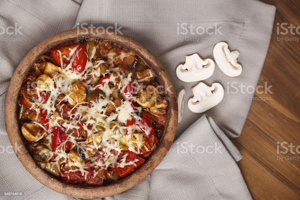 Roasted vegetables in a ceramic pot stock photo
