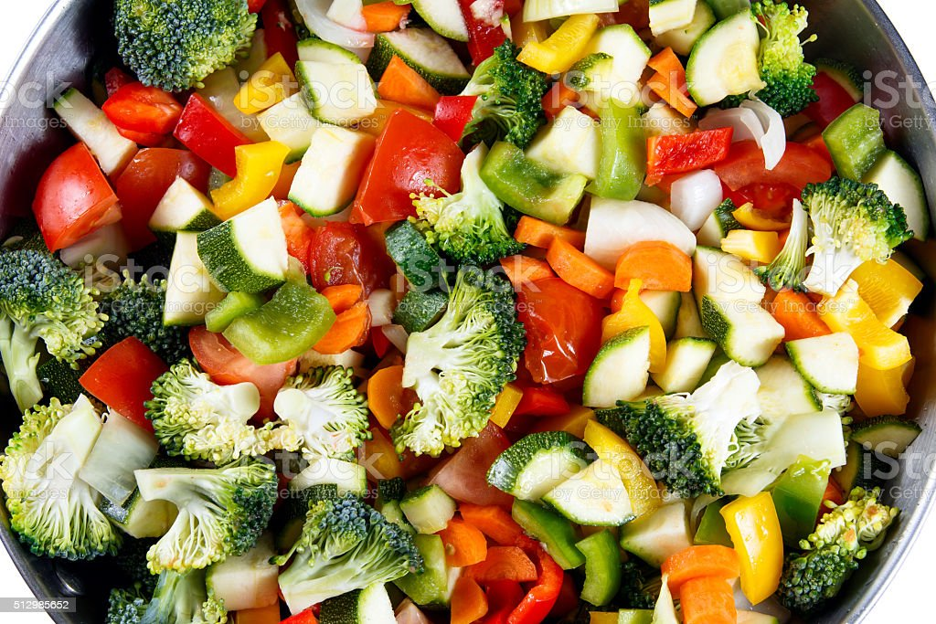 Roasted Vegetables, Tomatoes, Carrots, Peppers, Courgettes, brocoli, onion in wok stock photo
