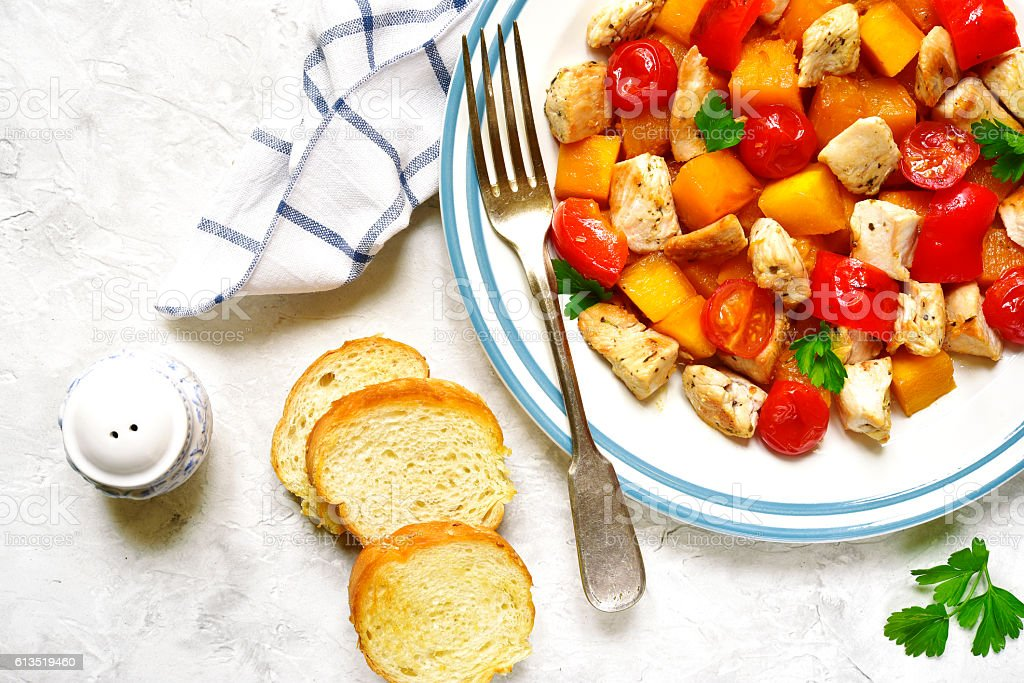 Roasted vegetables with chicken.Top view. stock photo